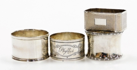Four silver napkin rings, comprising an Edwardian silver napkin ring, engine turned, Birmingham 1905, and three further napkin rings, 2.5oz. (4)