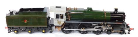 "A scratch built 5"" gauge British Railways Standard Class 5MT locomotive, 4-6-0, and tender, green livery, No 73173, with bespoke carry cases, 36cm high, 180cm wide, 23cm deep."
