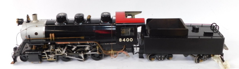 """A scratch built 3 1/2"""" gauge Southern Pacific Railroad Consolidation locomotive, 2-8-0., and ride on tender, silver and black livery, No 8400, with badges for the Baldwin Locomotive Works., Philadelphia 1912, with bespoke carry cases, 28cm high, 137cm wid"""