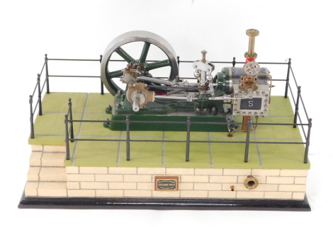 A Stuart Turner No 9 steam engine, scratch built, on a naturalistic fenced and bricked rectangular base, model 28cm wide.