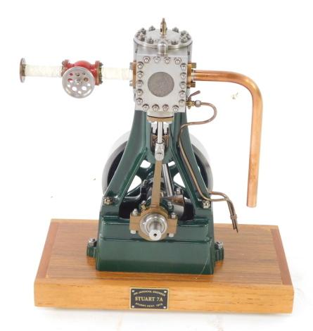 A Stuart Turner No 7A vertical steam engine, scratch built, on a rectangular wooden base, 19cm high.