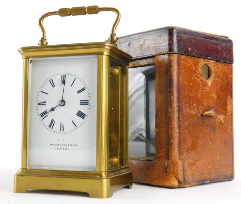 An early 20thC gilt brass carriage timepiece, marked for Brockbank & Atkins, London, in original leather case, 16cm high overall.
