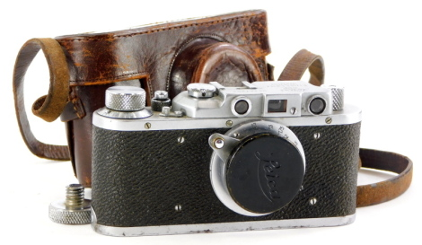 A Russian type Leica IIIa camera, serial number 357642, with a Leitz 5cm f3.5 Elmar lens, in a leather case.