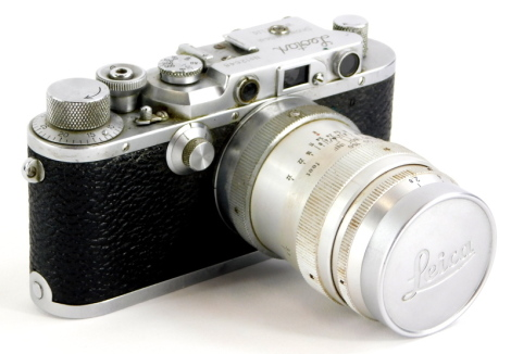 A 1947 Leotax Special DII camera, an exact Japanese copy of a Leica II, serial number 12648, the camera fitted with a Steinheil Munchen 8.5cm f2.8 Culminar lens, the body of the camera engraved 'Mioj,' signifying that the camera was made in occupied Japan