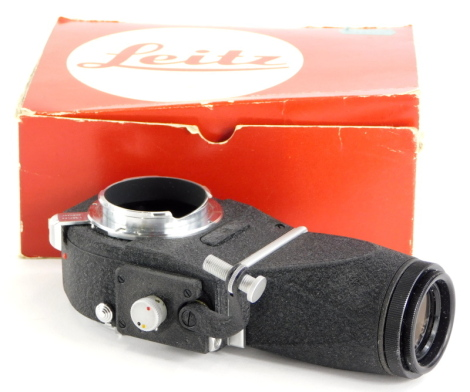 A Leitz Visoflex III with viewfinder, boxed.