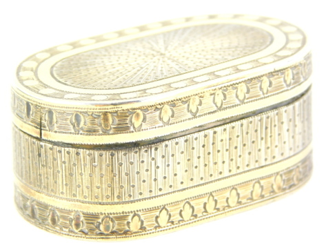 A George III silver and silver gilt rectangular nutmeg grater, with rounded corners and engine turned decoration, the hinged lid enclosing a pierced and hinged grill, London 1794, makers mark indistinct, 4cm wide. Auctioneer Announcement: We believe this