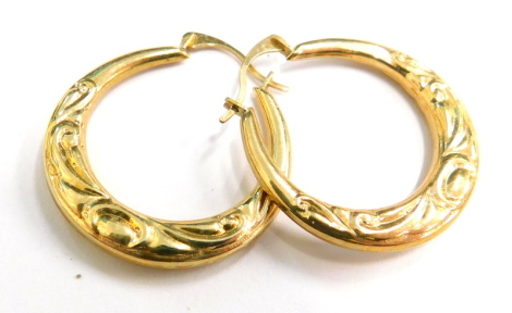 A pair of 9ct gold hoop earrings, each with an embossed decoration, in Elizabeth Duke box, 1.2g all in.