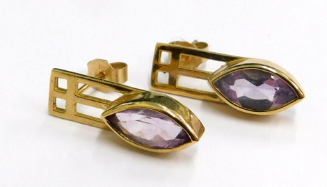 A pair of amethyst drop earrings, each with an amethyst drop, above a pierced top section, on a single stemmed butterfly back, yellow metal, stamped 9k, 2.6g.