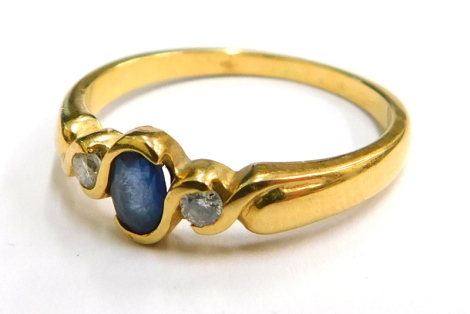 An 18ct gold sapphire and diamond ring, the central oval sapphire, on tube twist setting, with two tiny diamonds to each side, ring size O½, 3.3g all in, boxed.