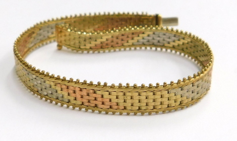 A 9ct gold tricolour bracelet, with silver, copper and gold bar effect design, with beaded supports, stamped Italy 375, 18½cm long, 9.6g.