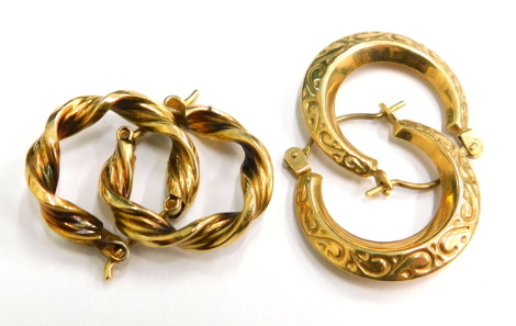 Two pairs of earrings, a pair of 9ct gold earrings one with etched scroll decoration, 1.1g, the other of twist design, gold plated (2).