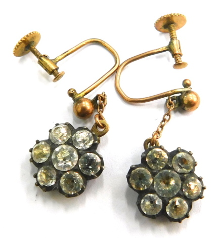 A pair of Victorian style dress earrings, each in the form of a floral cluster set with white paste stones, in a silvered coloured backing on a yellow metal butterfly frame, stamped 9c2, 3g all in.