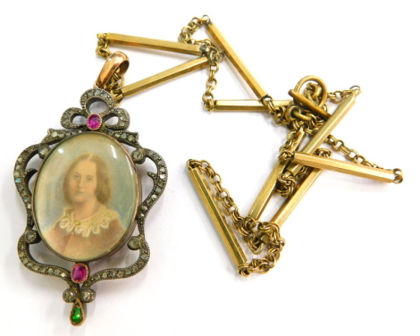 A Victorian portrait locket, set with marcasite pink and green stones, with an oval central portrait locket, in a gold coloured finish, unmarked, on a later plated chain, 5cm high, 3cm wide.