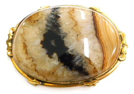 A Blue John set oval brooch, with a scroll design to the border, gold coloured unmarked, 6.5cm x 4.5cm.