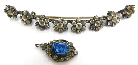 Two items of stone set jewellery, to include a crescent shaped brooch, set with eight floral cluster groups, each with paste stones, in a silvered gilt setting, but heavily worn, 10cm wide, and a part earring, in a similar style set with white paste stone