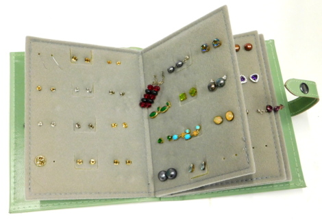 A quantity of mainly costume earrings, to include lapis, cut glass, fresh water pearls, and various simulated stones, contained in a Little Books of Earrings holder.
