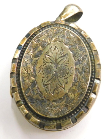 A Victorian memorial locket, with engraved floral design, silver plated with pendant loop, 4.5cm high.