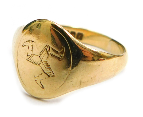 A 9ct gold signet ring, bearing the Isle of Man symbol, with maker's stamp LW Birmingham 1948, ring size L, 2.1g, boxed.