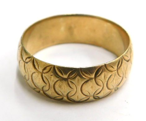 A 9ct gold wedding band, of circle etched design, numbered to interior 1142, London, ring size P½, 4.4g.