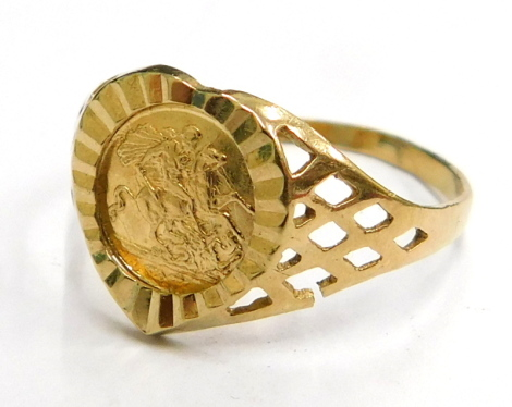 A 9ct gold heart shaped dress ring, the central panel with sovereign type decorated decoration, on a fine band, ring size L½, 1.1g.