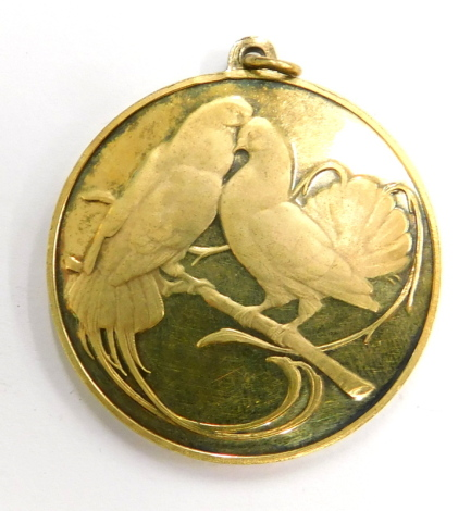 """A silver gilt French love token, with two doves and inscription """"in vous sans moi, ni moi sans vous"""" with pendant loop, 3cm wide, 14.2g."""
