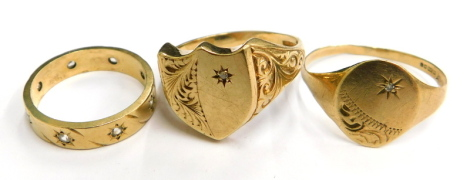 Three 9ct gold dress rings, to include a 9ct gold shield shaped dress ring, with scroll and carved sides and a tiny set panel, ring size T, another with oval panel and tiny set white stone, ring size U½, and an eternity ring set with tiny diamonds, ring s