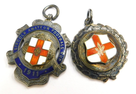 Two silver sporting medallions, to include The Lincoln Amateur Football Club 1911, with enamel decoration, and another Lincoln shield, 27.7g. (2)