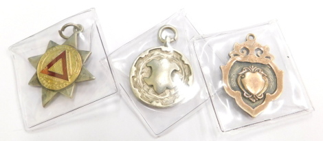 A group of silver and other medallions and fobs, to include a silver and silver gilt shield fob, a circular silver fob with central shield crest, a silver and gold 10 year Safe Drive National Safety First Association medallion for M Harrop, 27.4g all in.