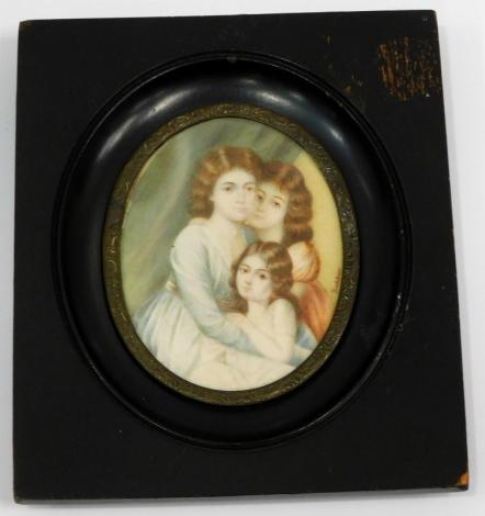 A colour print triple portrait minature, 14cm x 12cm inc. frame.