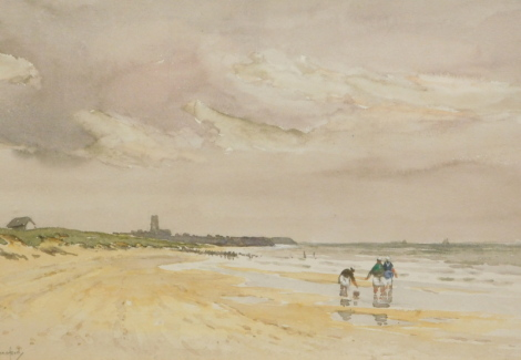 Charles E. Hanniford (1865-1955). Seascape, views on a beach before buildings in the distance, watercolour, signed, 25cm x 38cm. Label verso.