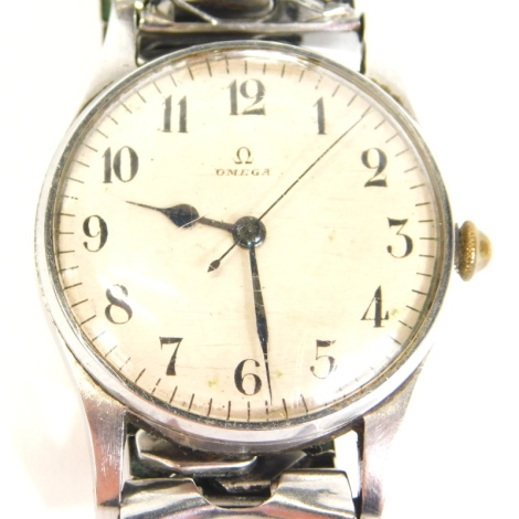 An Omega Air Ministry gentleman's wristwatch, with a white dial with Arabic numerals, stainless steel case, with associated strap, engraved to the reverse A M, 6B/159,3495/42, the dial 3cm diameter.