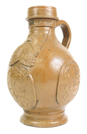 A stoneware Bellarmine jug, decorated with a bearded mask and with three continental crests, within oval tablets, 23.5cm high.