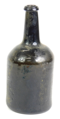 A late 18th/early 19thC green glass wine bottle, with deep indent to underside, 22cm high.