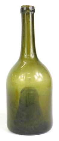 A late 18th/early 19thC green glass wine bottle, with deep indent to underside, 26cm high.