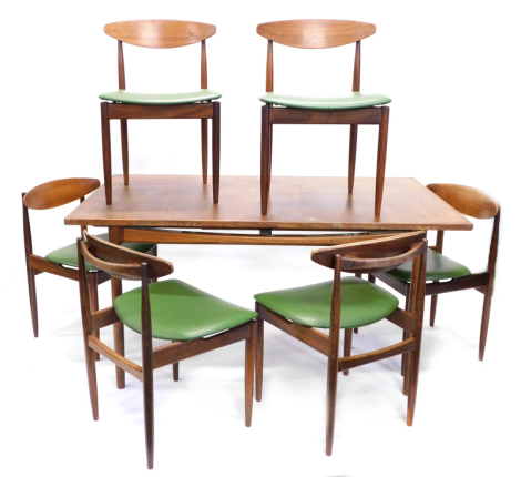 A G-plan Danish design teak extending dining table, with a rectangular top, with a plain frieze on turned legs, 72cm high, the top 89cm x 153cm enclosed, and six chairs, each with a shaped back and leatherette upholstery. The upholstery in this lot does n