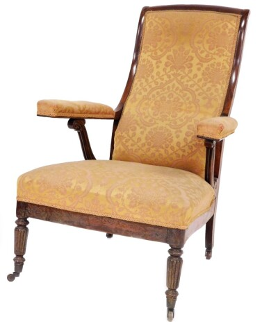 A Regency rosewood library open armchair, in the manner of Jas. Shoolbred & Co., with high scrolling back, fluted scroll arm supports in Damask upholstery, over upholstered seat on slender turned and fluted legs with brass castors. Provenance: Newbold Pac
