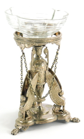 An Elkington and Co silver plated stand, in French Empire style, with a central three handled vase, the trefoil base mounted with three winged Egyptian style figures on paw feet, associated glass bowl, 18.5cm high.