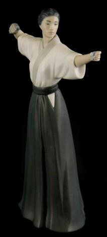 A Lladro matte glazed porcelain figure of a Japanese female archer, impress marks to underside 8290, (AF), 31cm high.
