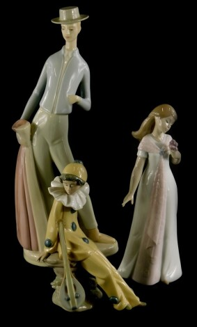 Three Spanish porcelain figures, to include a Nao Pierrot, a young girl holding a posy of flowers and another figure of a Matador. (3)
