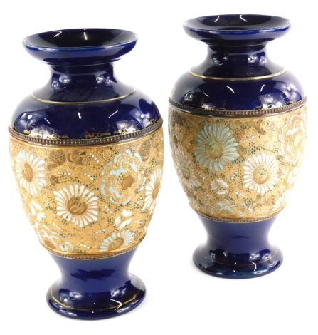 A pair of Doulton Slaters patent vases, each decorated with flowers in white and turquoise in cobalt blue and gilt borders, impress marks to underside, 29cm high.