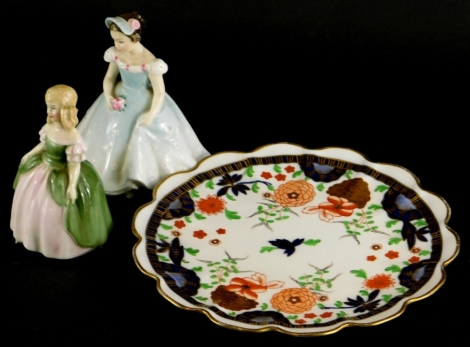 Two Royal Doulton figures of Penny and The Bridesmaid, and a Shelley Imari patterned plate decorated with flowers, etc. (3)