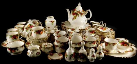 A large collection of Royal Albert Old Country Roses pattern porcelain, to include two teapots, cups, saucers, two circular boxes and covers, place mats, dinner plates, etc.