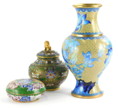 Three items of oriental cloisonne, to include a jar and cover with lion mount to the lid, 13cm high, a vase decorated with blue flowers, 23cm high, and a box and cover.