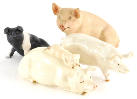 Two Beswick pigs, to include a figure of a pig with a piglet, another Champion Wall Queen, a Country Life Design Studio matte glazed pig and an Aynsley pig. (4)