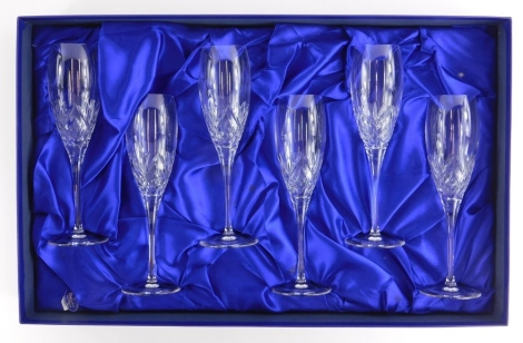 A set of six Royal Doulton cut glass champagne flutes, in original box with packaging.