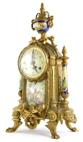 A 20thC continental mantel clock, the brass case decorated with scrolls, swags, etc., with painted dial above a ceramic panel, indistinctly signed, flanked by painted pillars, 42cm high.