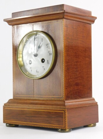 An Edwardian mahogany boxwood strung and chequer banded mantel clock, with white enamel dial, on bun feet, 28cm high.