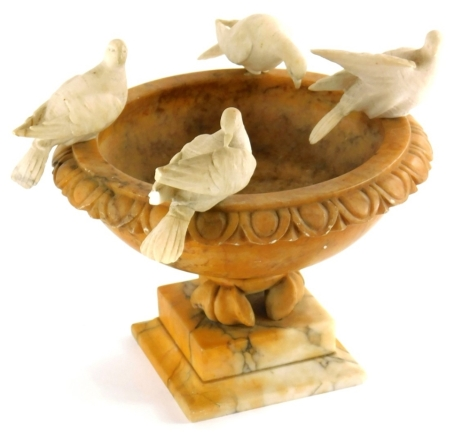 A late 19thC Grand Tour carved alabaster urn, mounted with the Four Doves of Pliny, 23cm wide.