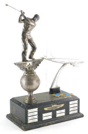 The Pan American Golf Trophy, with ebonised base mounted with a silver plated golfer and an aeroplane, recipients dated from 1959-1970, 53cm high, and three Pan American airlines pin badges.