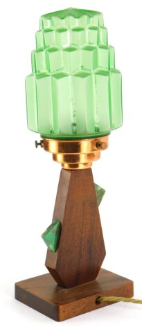 An Art Deco lamp base, the green moulded shade of tapering form with a copper fitting, the mahogany base applied with green marble Bakelite, 37cm high.This lot contains untested or unsafe electrical items. It is supplied for scrap or re-conditioning only